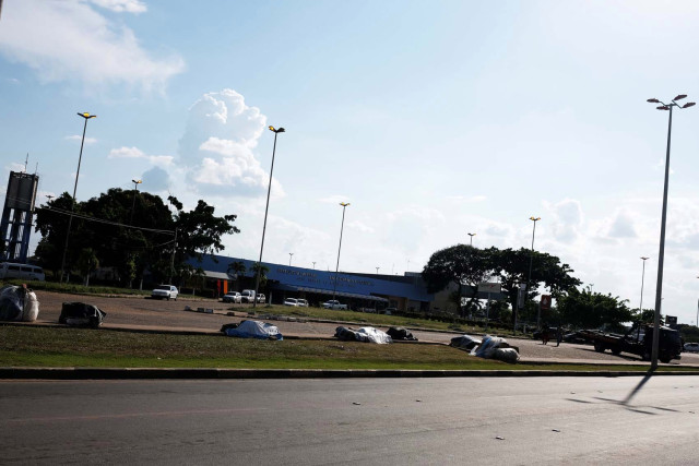 Belongings of Venezuelan people are seen on the grass in front of interstate Bus Station in Boa Vista, Roraima state, Brazil August 24, 2018. Pc